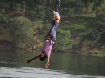 Tourist bungee jumping over River Nile