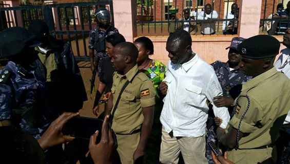 Besigye being escorted by Police