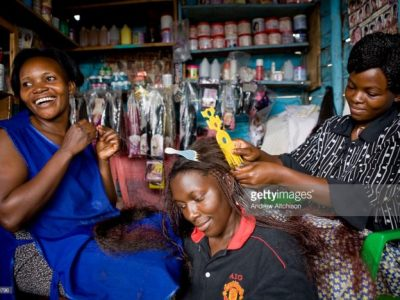 Ugandan women in a hair dressing shop